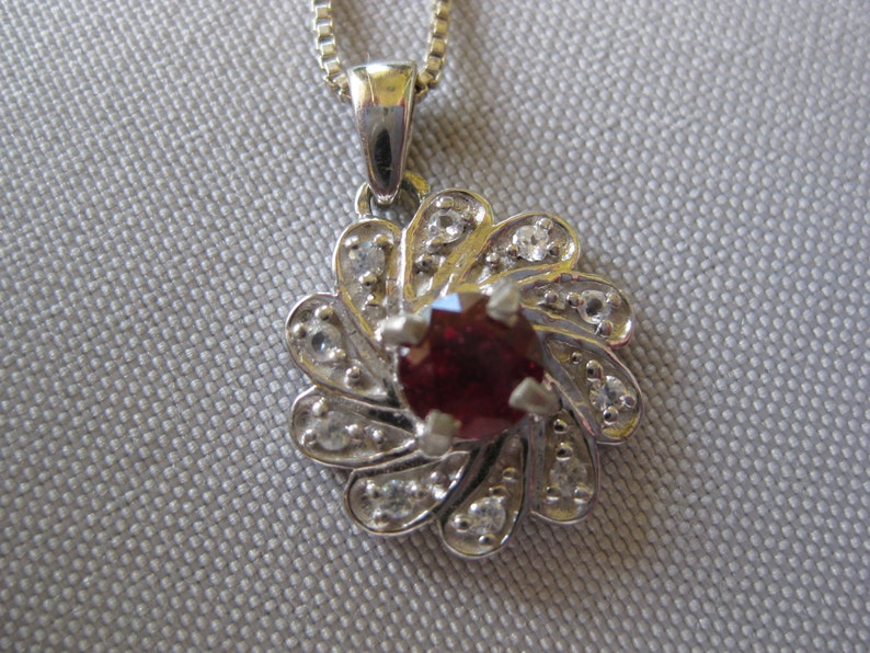 Ruby and Zircon Gemstones set in Sterling Silver Pendant With image 0