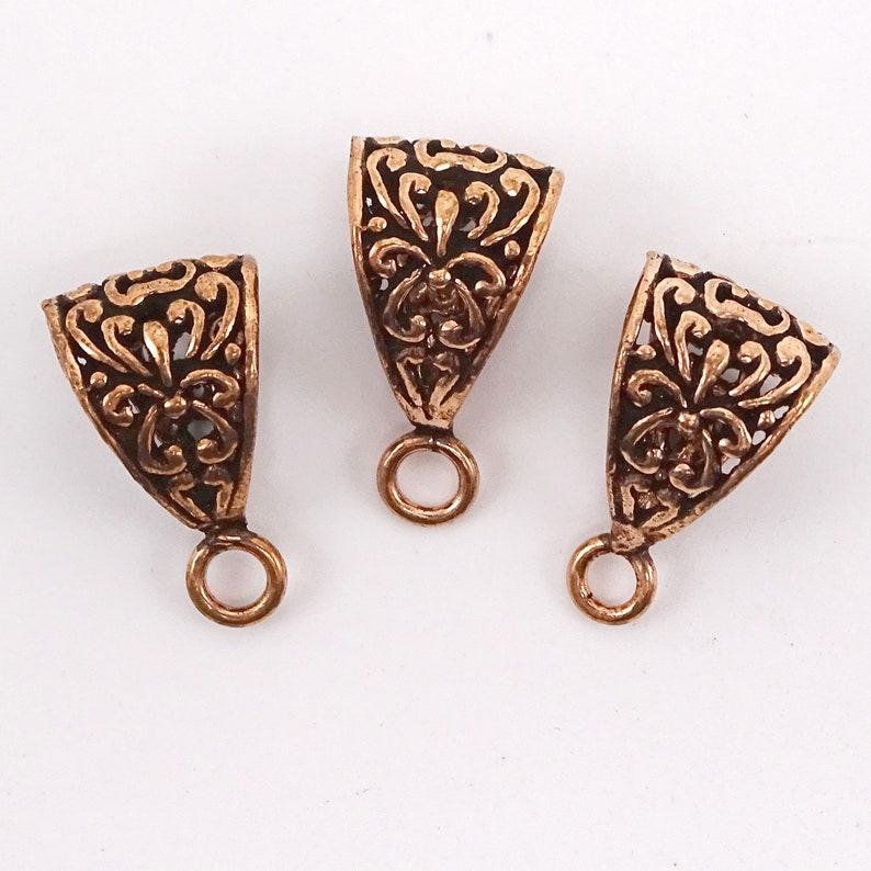 | 53-7636 Solid Copper Closed Loop Bail Lotus Flower Pattern--21mm L --1 Pc 78