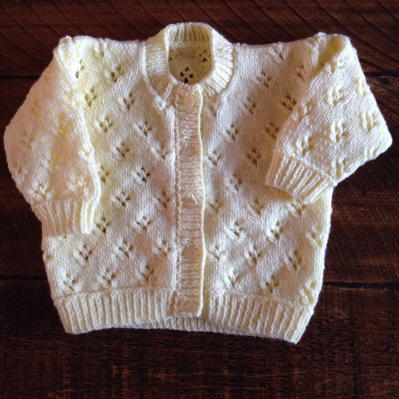 Pretty hand knitted baby cardigan available in choice of image 1