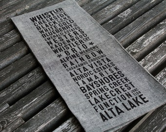 Whistler Neighbourhoods Bus Scroll Tea Towel