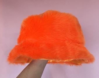 527b7638 Neon orange faux fur bucket hat - unisex