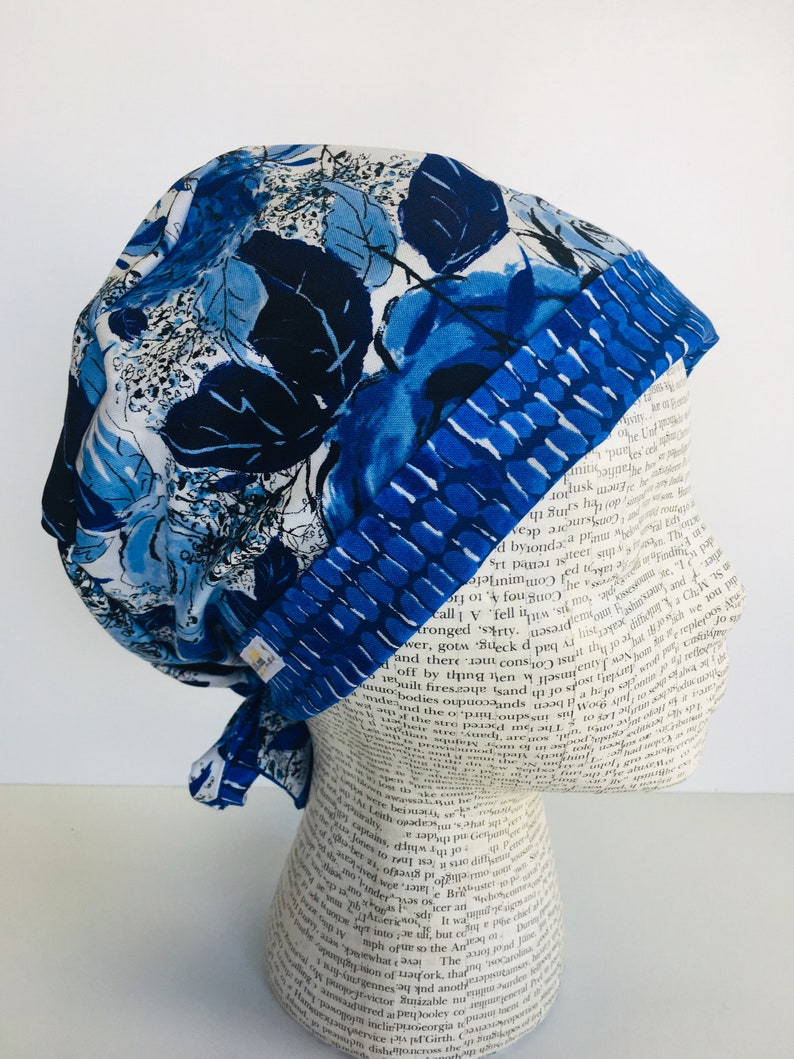 0b0f843243b Tie Back Scrub Cap with a white fabric and flowers in shades
