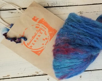 Merino blends of Blue, reds, multiple silk threads and sparkle