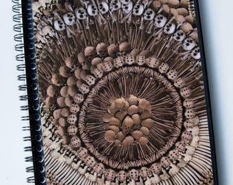 """Alexander McQueen A5 (21x15cm) spiral notebook made with """"Catacomb' print paper."""