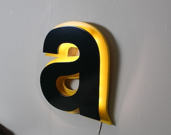 Letter light a green and yellow sign industrial type