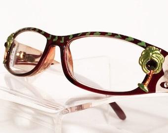 a92dd5a61ff72 Palm Tree avec des lunettes de lecture noix de coco