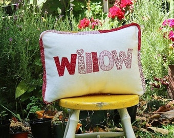 Name cushion & bunting in bright red florals