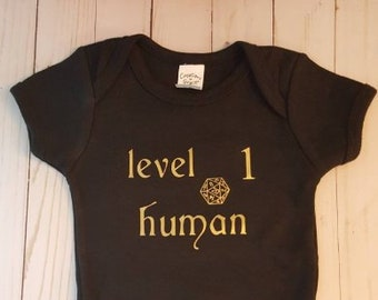 9645ec7e9 Baby Bodysuit Dungeons and Dragons, D&D, Gamer Baby, Gaming Bodysuit, Level  1 Human! Black with Matte Gold Letters!