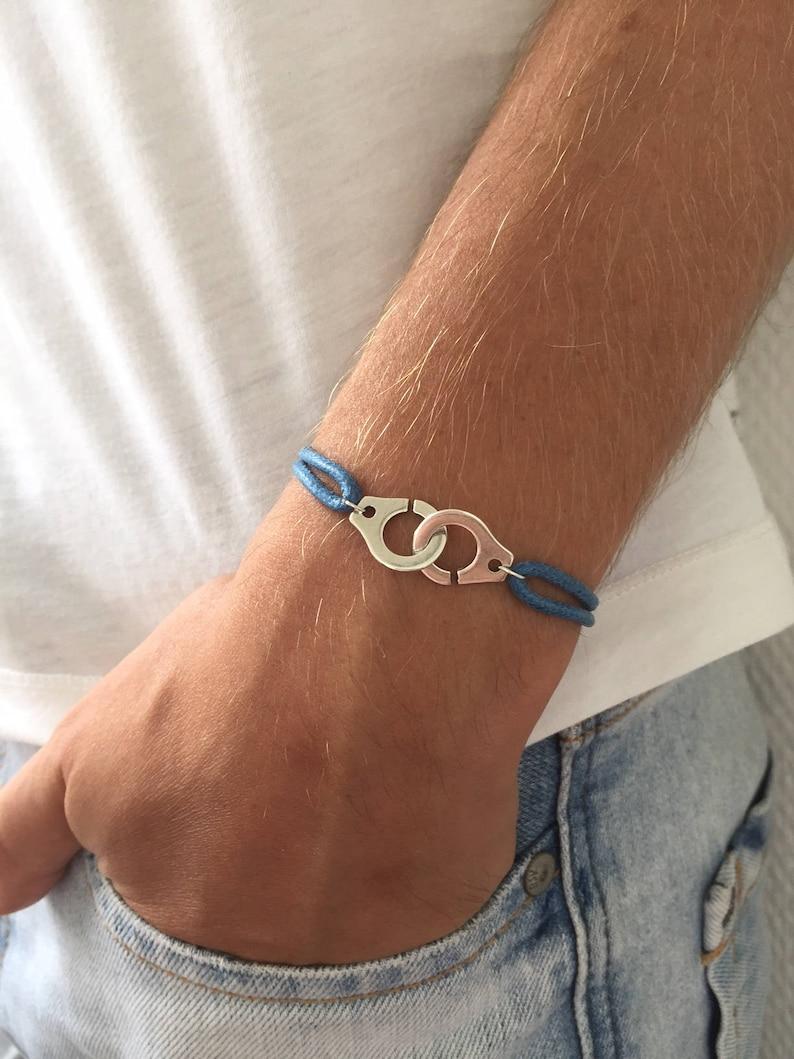 86428bb0803 Bracelet menottes sur cordon