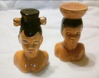 Ethnicity unknown couple with large headdress Vintage salt and pepper shakers