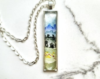 Watercolor mountain and meadow landscape pendant, hand painted necklace in blues and greens
