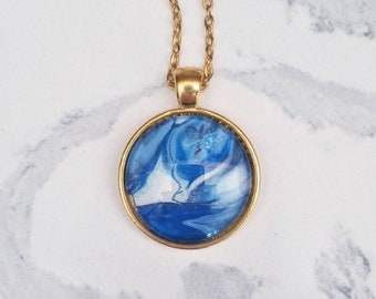 Hand-painted blue abstract pendant necklace in gold-plated. Wearable art acrylic miniature painting Pantone 2020 color of the year