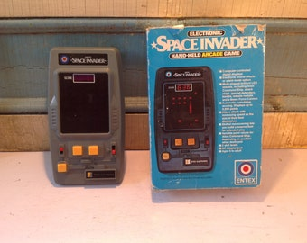 Vintage electronic space invader hand held 1981 arcade