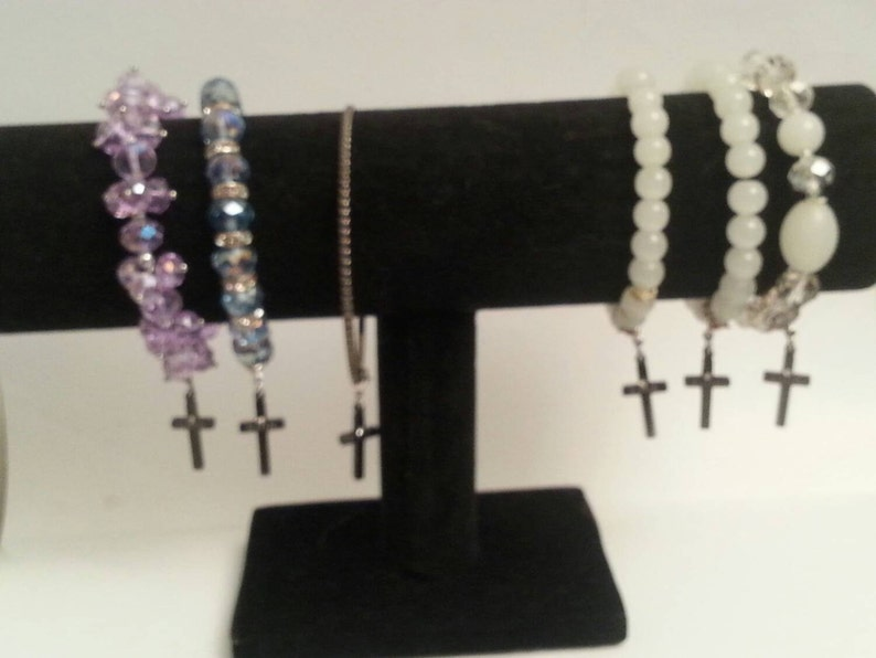 engraved /'Faith/' Onyx cross charm made from stainless steel Clasp makes it interchangeable for all purposes. with an added gem