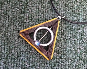 """Deathly Hallows - """"Piercing"""" necklace pendant harry potter"""