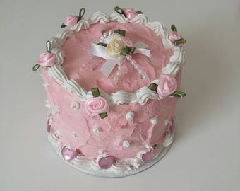 Fake cake pink and white with roses and hearts