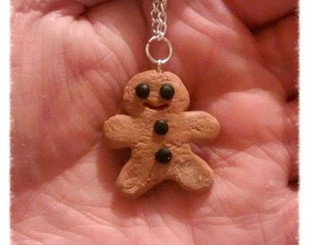 Polymer clay ginger bread man on a silver chain. or keychain or character for your Ginger bread house. Nice Christmas necklace jewellery.