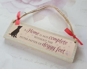 A home is not complete without the pitter patter of doggy feet - wooden plaque