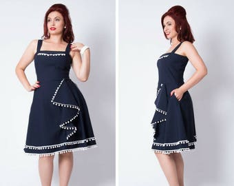 Navy blue retro swing dress with white pompom trims and side pockets