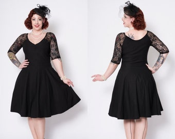 Black stretch pinup swing dress with lace sleeves and side pockets