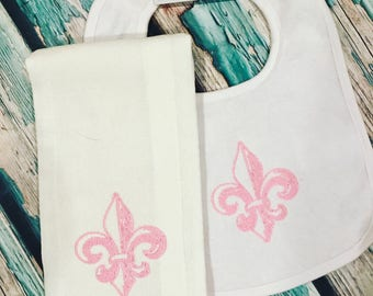 Pink fleur de lis bib and burp cloth set