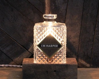 Recycled I.W. Harper Bourbon Bottle Lamp, Features Reclaimed Wood Base, Edison Bulb, Twisted Cloth Wire, In line Switch, And Plug