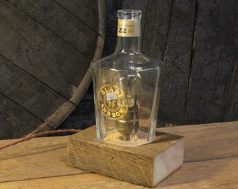 Handmade Recycled Blade And Bow Bourbon Bottle Lamp-Features Reclaimed Wood Base, Edison Bulb, Twisted Cloth Wire, In line Switch, & Plug