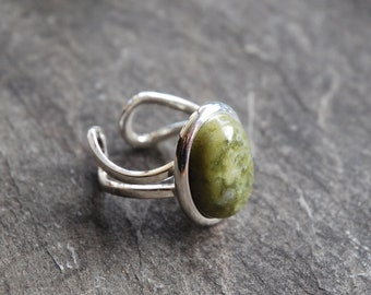 Irish Connemara Marble ring with 13 x 18mm stone. Adjustable and great quality. Made and posted from Ireland