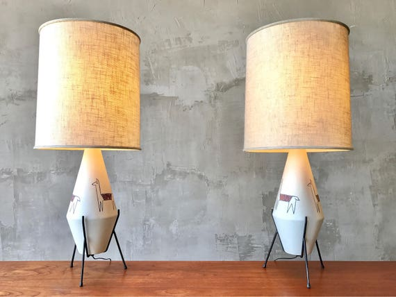 Pair of Modernist Llama Lamps.