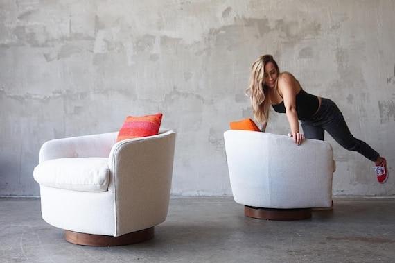Pair of Milo Baughman Swivel Chairs.
