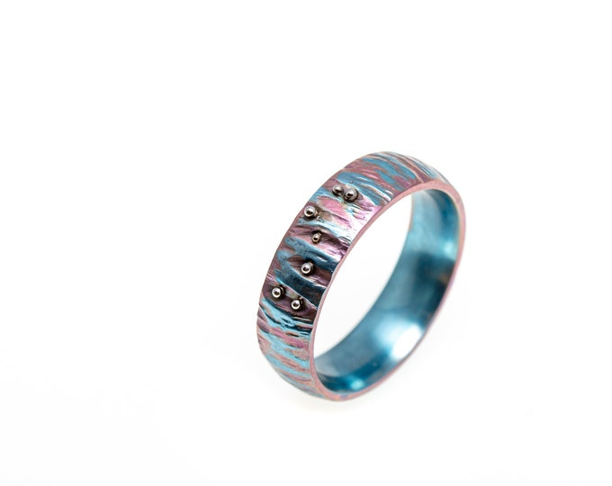 Featured listing image: Access Code. Titanium Textured Ring. Hypoallergenic. Welding. Anodizing. Made in Finland.