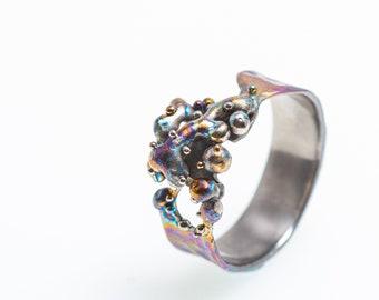 El Payaso. Statement ring. Pure Grade Titanium. Unique piece. Hypoallergenic. Art Welding. Anodizing. Handcrafted in Finland