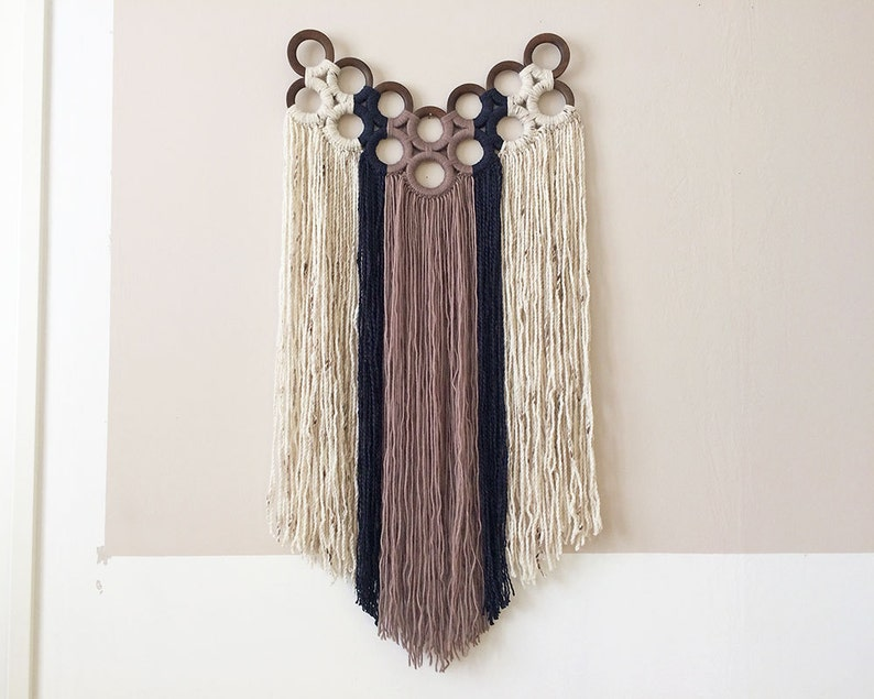 macrame wall hanging with yarn wrapped wooden curtain rings  image 0