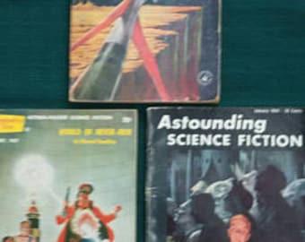 "Lot of 3 Vintage Sci-Fi paperbacks 1954, '57 & '60 ""Amazing science fiction""  ""Astounding Science Fiction"" ""World of Never-Men"" Assemblage"