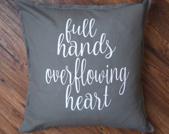 Full hands overflowing heart decorative pillow