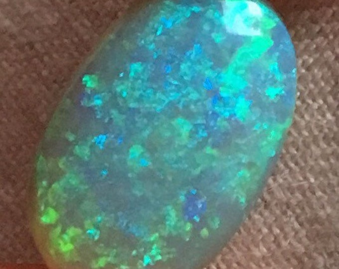4.99ct Oval Opal Cabachon with Blue Colour