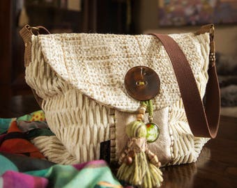 Unique messenger bag. Handmade using luxurious designer, upcycled  textiles in shades of cream. Leather, wool and coconut button accents.