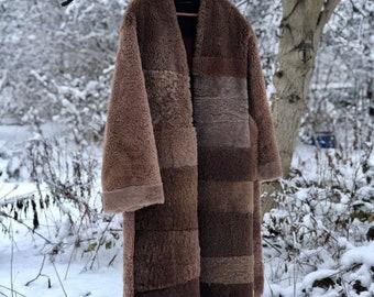 upcycled sheepskin long coat with fringe - sustainable zero waste design