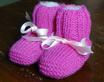 Knitting booties for baby girl