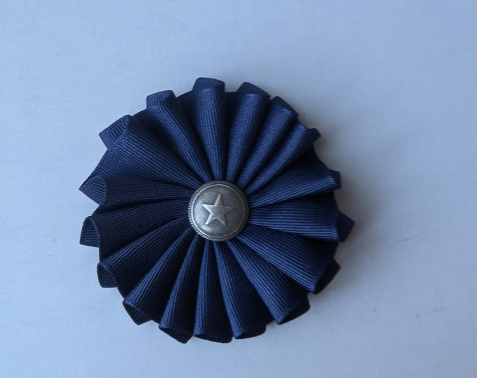 Small Folded Blue Protestor's Cockade for Hats or Clothing
