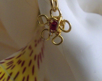 Earcuff*gold-plated handcrafted wire flower* dark red bead center *flower charm*non piercing cartilage jewelry