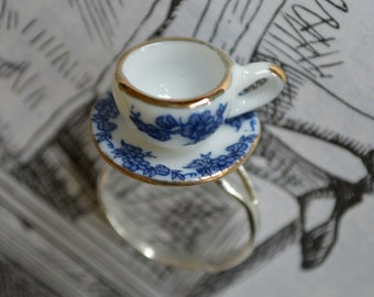 """Alice In Wonderland """"Curiouser and Curiouser"""" Blue, White and Gold Tea Cup Ring."""