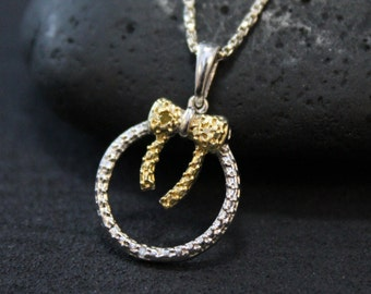 Sterling Silver Two Tone Gold and Silver Bow and Circle Necklace on 15 and 1/2 inch Chain