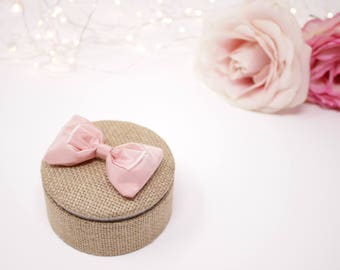 Round jute and linen white, pink silk bow wedding ring.