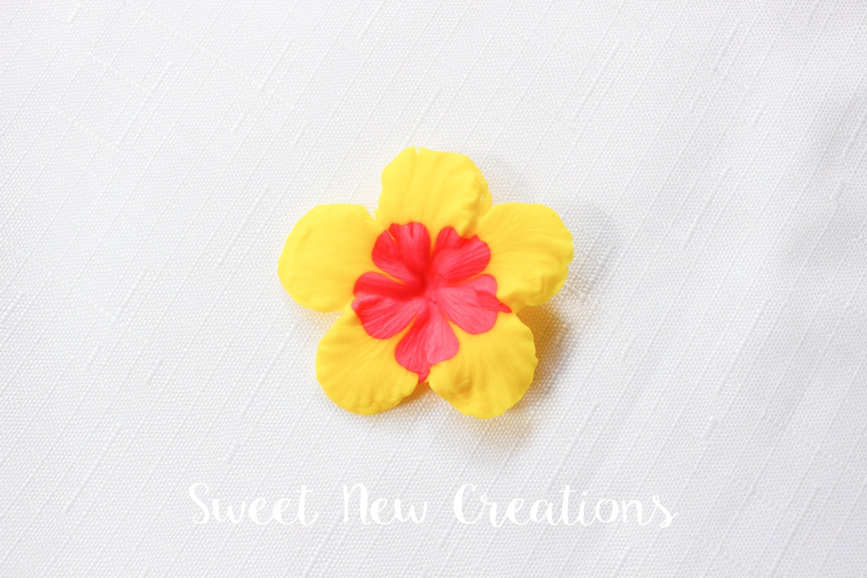 Yellow hibiscus edible fondant flowers 2 luau cupcake etsy yellow hibiscus edible fondant flowers 2 luau cupcake toppers bright color tropical hawaiian flower cake topper hot pink yellow izmirmasajfo