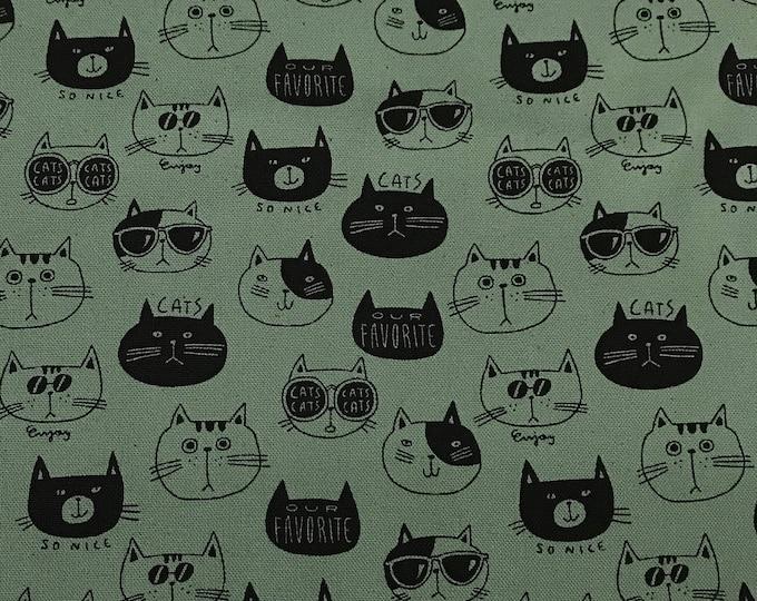Kokka - Cat Faces on Dusty Green - Cotton Canvas