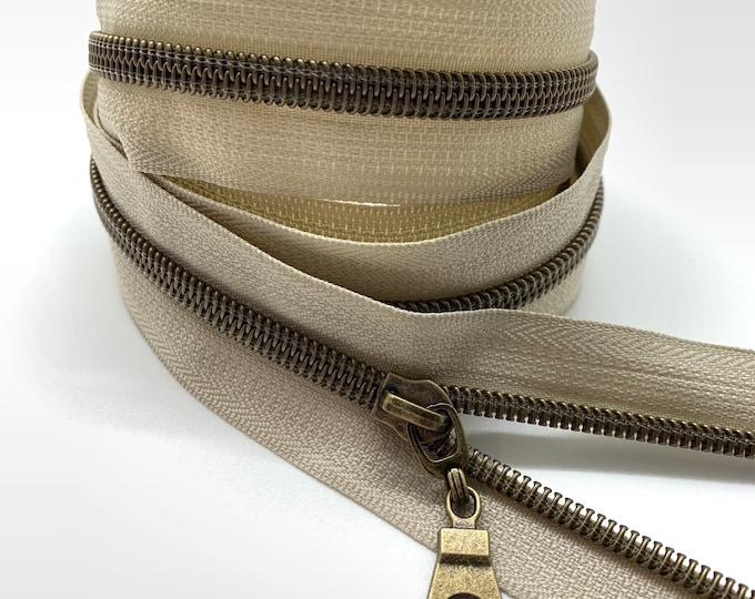 Antique Brass Nylon Coil Zipper (#5 Size) with Beige Tape & Antique Brass Pulls - Zipper by the Yard - Nylon Coil Zipper - Metallic Zipper
