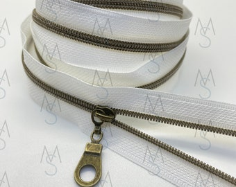 Antique Brass Nylon Coil Zipper (#3 Size) with White Tape & Antique Brass Pulls - Zipper by the Yard - Nylon Coil Zipper - Metallic Zipper