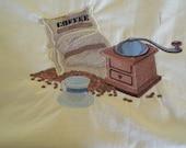 Embroidered art work, coffee scene