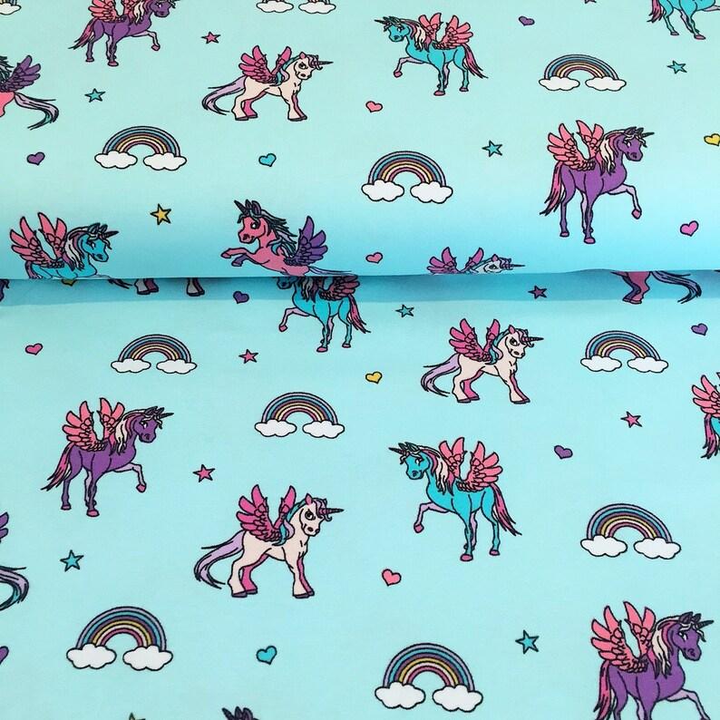 8c3e348e497 HALF METRE Light Blue Unicorn Print Jersey Knit Fabric | Etsy